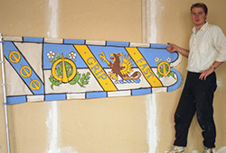This was one of 55 different banners that had to be painted (on both sides!).